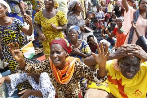 Image: Members of the Women's Christian Association pray for peace in Abidjan, Ivory Coast
