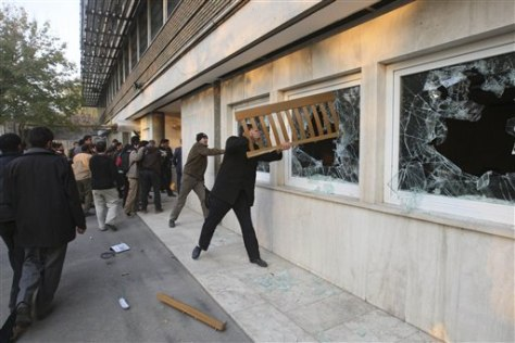 Image: Iranian protesters break the windows of a British Embassy building, in Tehran, Iran