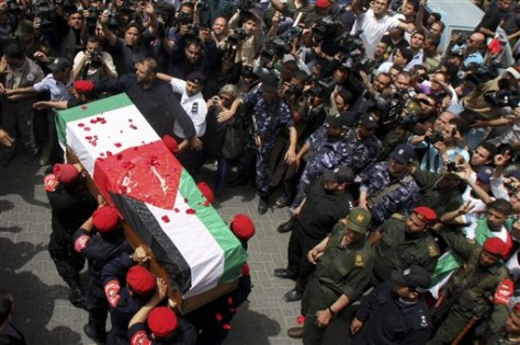 Image: Palestinian Hamas security personnel carry the coffin of Italian activist Vittorio Arrigoni