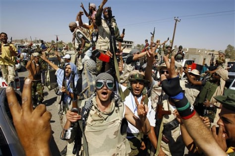 Image: Libyan fighters chant after taking control of loyalist villages
