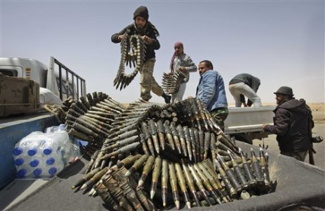 Image: Libyan rebel fighters load a truck