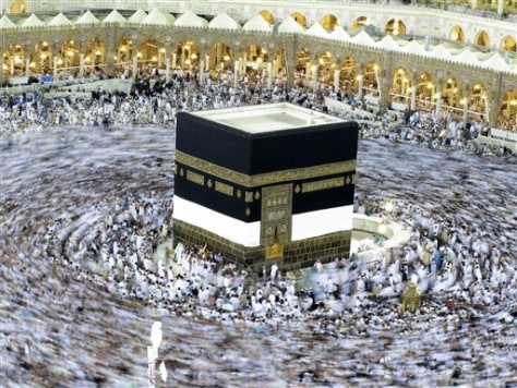 Image: Muslim pilgrims move around the Kaaba