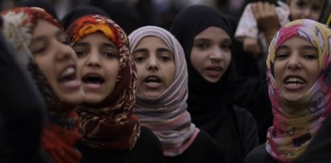 Image: Anti-government protesters chant slogans Saturday during a demonstration in Sanaa, Yemen.