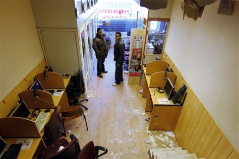 Image: Dutch authorities searched the Banadir Internet cafe in Rotterdam