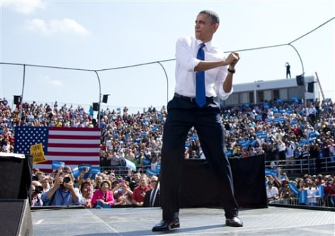 Image: President Barack Obama swings with an imaginary bat as he arrives on stage to speak at a campaign event at G. Richard Pfitzner Stadium, Friday, in Woodbridge, Va.