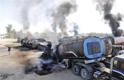 Image: A burning oil tanker