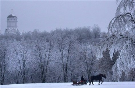Image: A man rides a sleigh in the Kolomenskoe park on the bank of the Moskva River