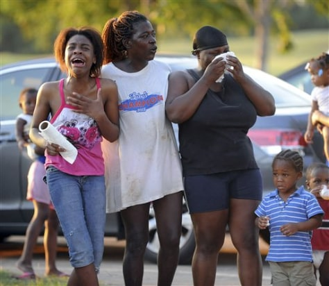Image: Relatives react as rescuers search for drowned teens