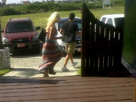 Image: Robyn Gardner and Gary V. Giordano leave restaurant in Aruba on Aug. 2.
