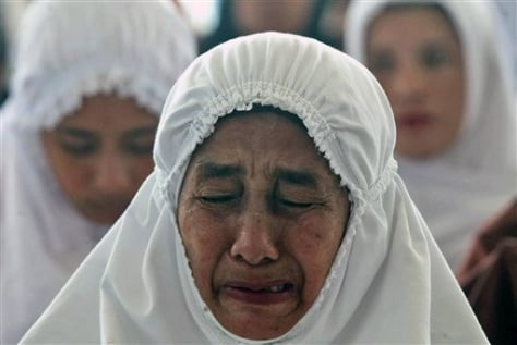 Image: A woman weeps