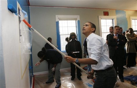 Image: Barack Obama painting a shelter wall