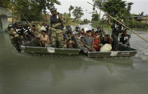 Image: Flood evacuees on raft