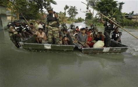 Image: Flood evacuees on raft