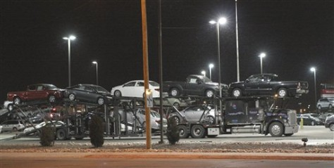 Image: Dealership's cars being loaded onto truck