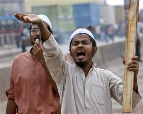 Image: Islamic activist armed with a stick