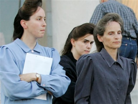 IMAGE: WOMEN LEAVE COURT