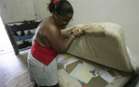 Image: Woman in room at temporary housing