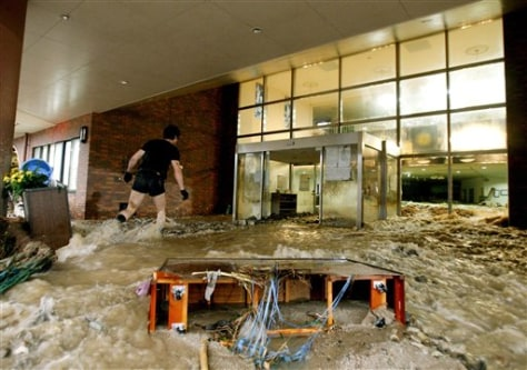Image: Flood water gushes out of nursing home