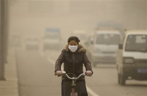IMAGE: CHINESE BIKE RIDER WEARING MASK