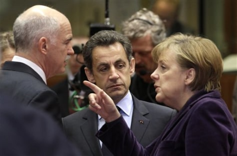 Image: German Chancellor Angela Merkel, right, speaks with Greek Prime Minister George Papandreou, left, and French President Nicolas Sarkozy