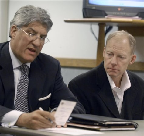 Image: Curt Johnson, former chairman of Diversey, Inc., and defense attorney Michael Hart in Racine, Wis., County Circuit Court