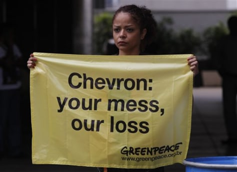 Image: Greenpeace activist protests Chevron