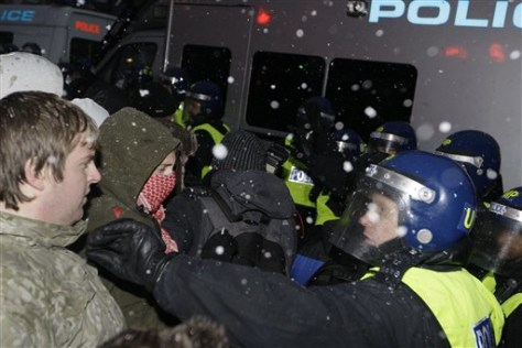 Image: British police officers clash with protesters