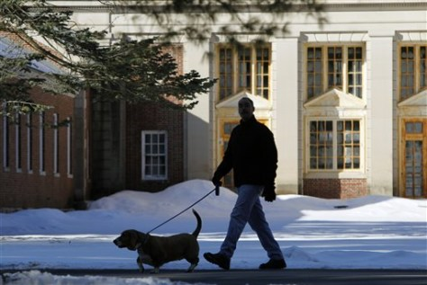 Image: Man walks dog at Saratoga Spa State Park.