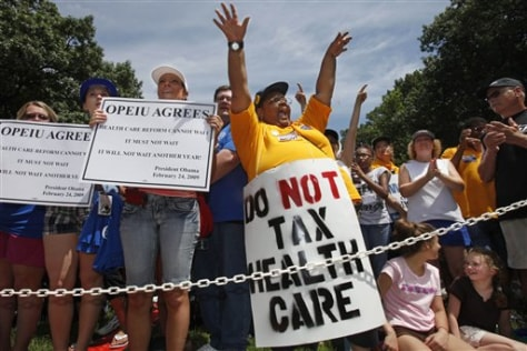 Image: People cheer during a health care rally