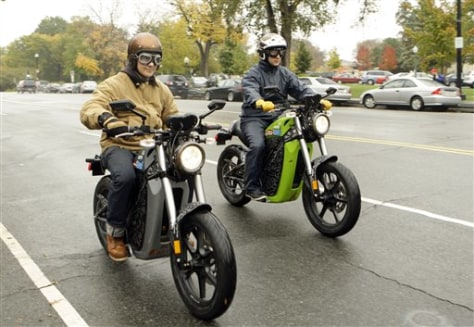 Image: Company execs on electric motorcycles