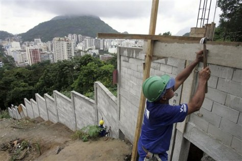Image: Worker builds a wall