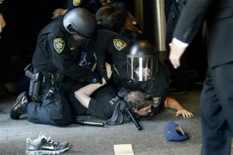 Image: Protesters are handcuffed
