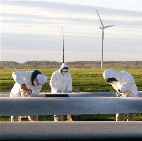 IMAGE: STUDENTS WORK ON WIND TURBINE