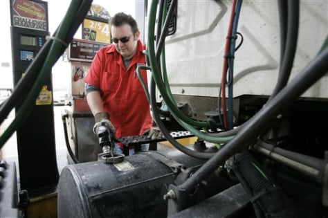 Image: Man fills semi with diesel fuel