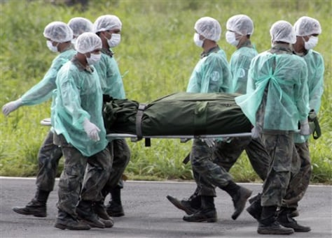 Image: Brazilian Air Force personnel carry a body