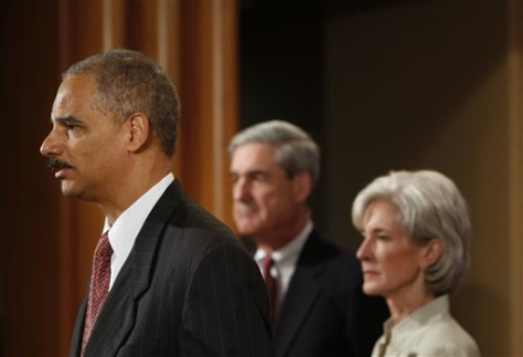 Image: Eric Holder, left, Robert Mueller, center, Kathleen Sebelius