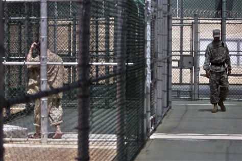 Image: Gitmo detainee in fenced area