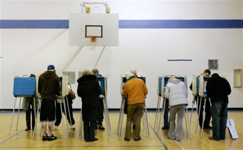 IMAGE: Voters casting their ballots