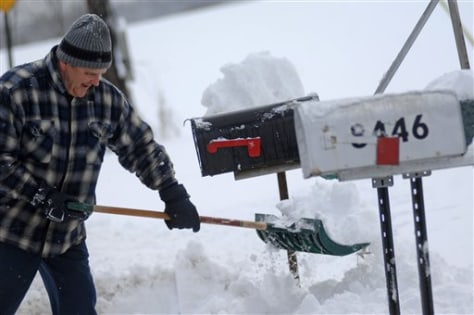 Image: Man shovels snow