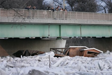 Image: Destroyed home in icy river
