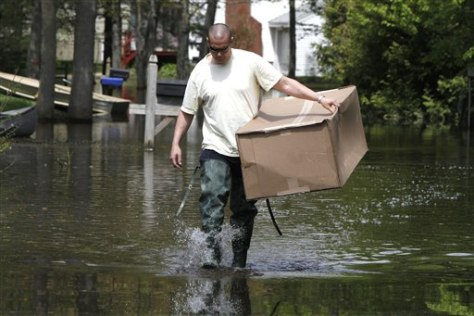 Image: Jim Brault walks down a flooded street