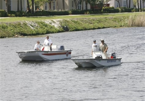 Image: Officials search canal