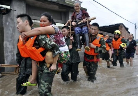 Image; Rescue workers evacuate residents
