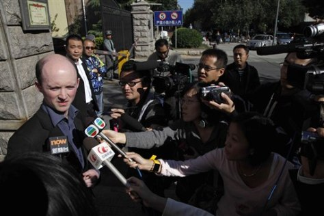 Image: Simon Sharpe outside Liu Xia's home