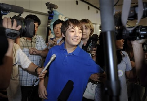Image: Jonathan Lee, 13, arrives in Beijing, China, from North Korea.