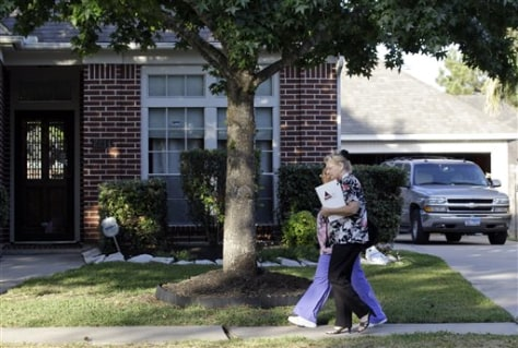 Image: Healthcare workers leave the home of astronaut Mark Kelly, husband of Rep. Gabrielle Giffords, in League City, Texas.