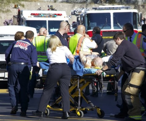 Image: Emergency personnel attend to a shooting victim