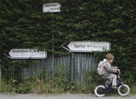 Image: Boy on bike in Flemish town