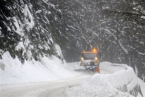 Image: A snow plow clears a road