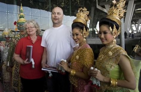 Image: Tourists greeted at Thai airport.